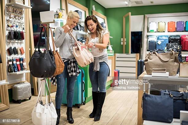 Female customers in luggage store