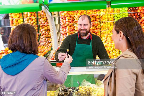 Female customers shopping in greengrocers shop