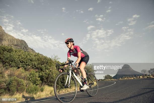 Female cyclist on her road bike