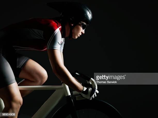 Female cyclist riding track bike