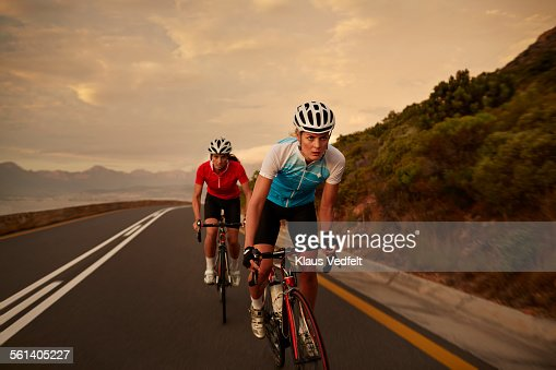 Female cyclist taking lead in sprint : Stock Photo