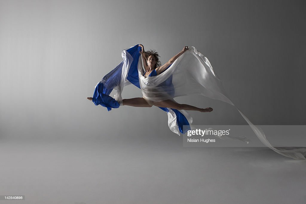 Female Dancer performing a grand jeté : Stock Photo