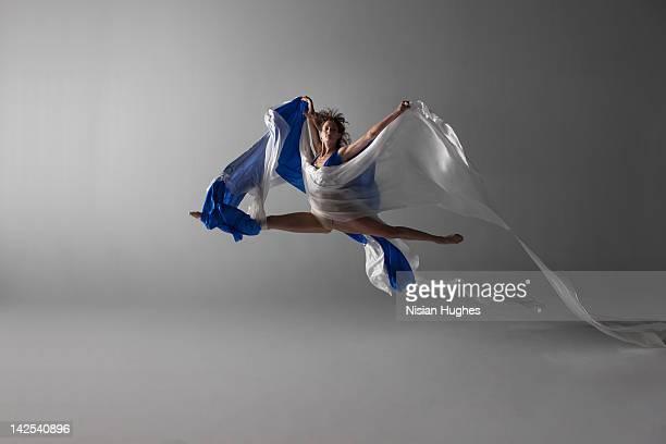 Female Dancer performing a grand jeté