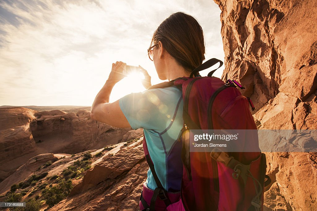 A female dayhiking in Arches Park. : Stock Photo