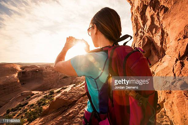 A female dayhiking in Arches Park.