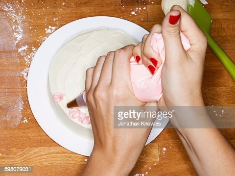 Female decorating a cake