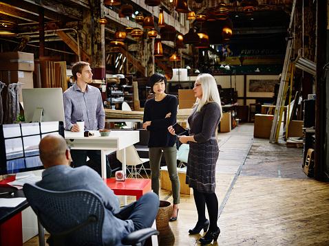 Female designer leading informal group meeting