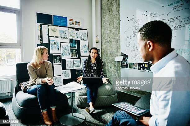 Female designer leading planning meeting in office