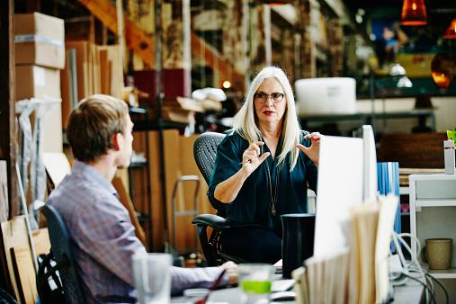 Female designer leading project discussion