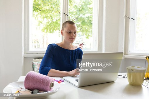 Female designer using laptop in office