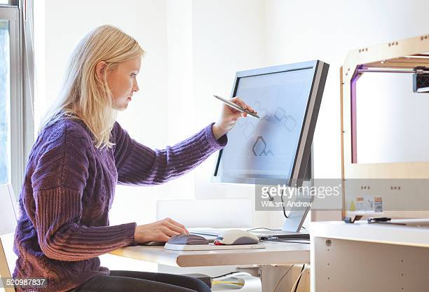 Female designer working on computer aided design