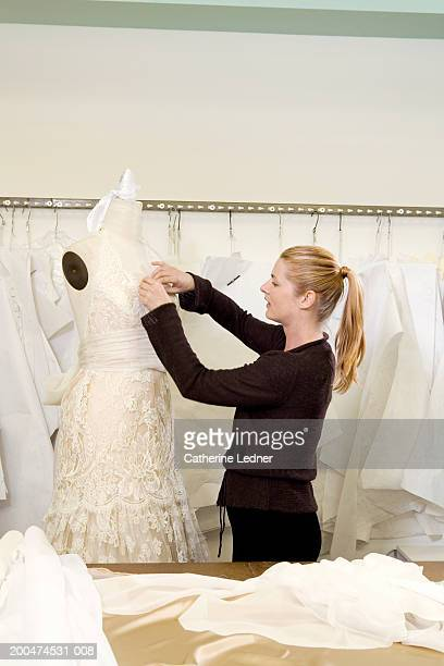 Female designer working on  dress