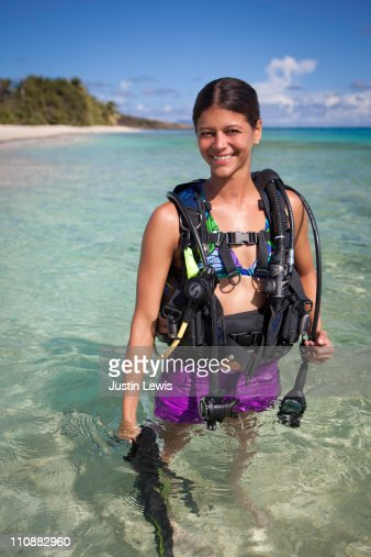 female diver with dive gear in tropical setting : Bildbanksbilder