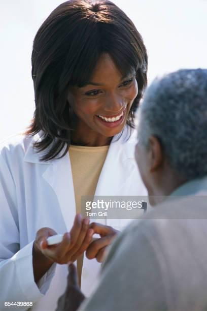 Female Doctor Administering Medication