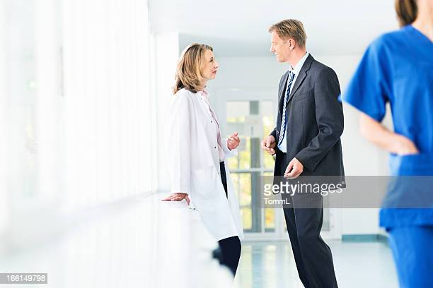 Female Doctor And Businessman