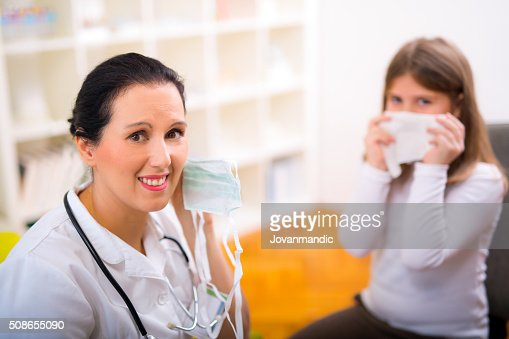 Female doctor and little girl patient.  Medical examination. : Stock Photo