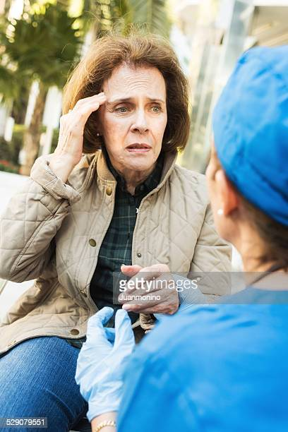 Female doctor assisting a senior woman