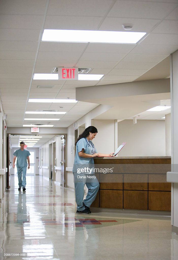 Female doctor at reception desk in hospital