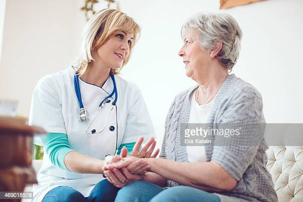 Female doctor examines her senior patient