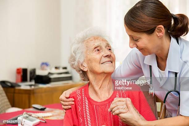 Female doctor examines her senior patient