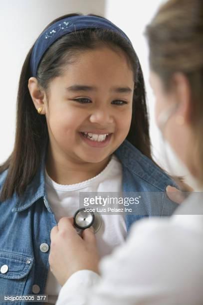 Female doctor examining a girl