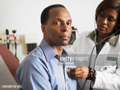 Female doctor examining patient : Stock Photo