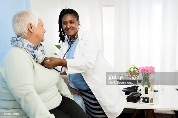 Female Doctor Examining Senior Female Patient