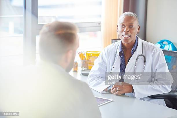 female doctor gives diagnosis