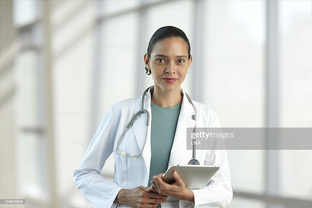 Female Doctor Holding Digital Tablet : Stock Photo