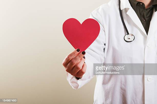 Female Doctor holding Heart