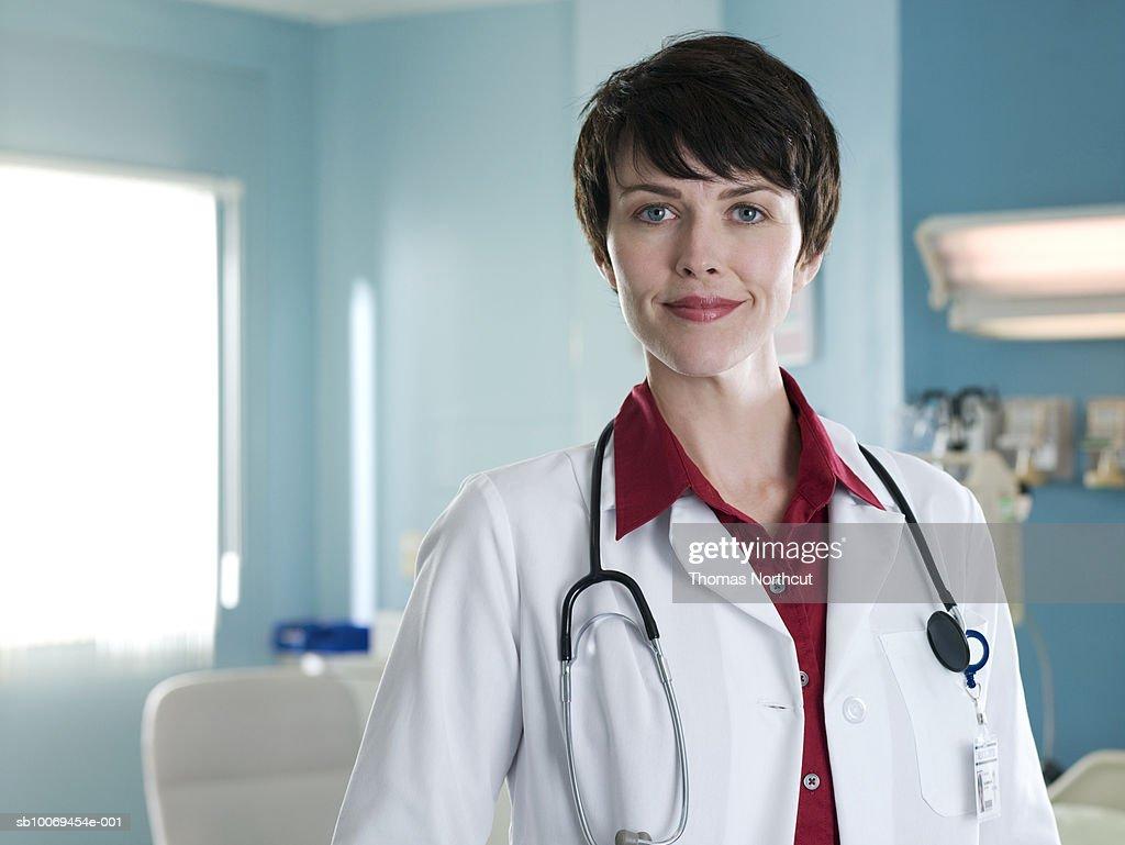 Female doctor in hospital room, portrait : Stock Photo