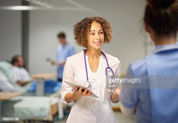 female doctor in team meeting