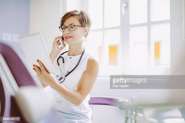Female doctor is working in the surgery