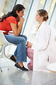 Female Doctor Offering Counselling To Depressed Woman