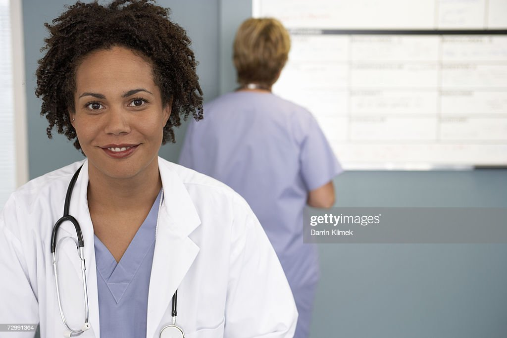 'Female doctor smiling, portrait, close-up' : Stock Photo