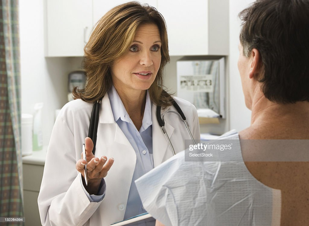 Female doctor talking to a patient : Stock Photo