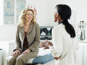 Female doctor talking to patient in medical room