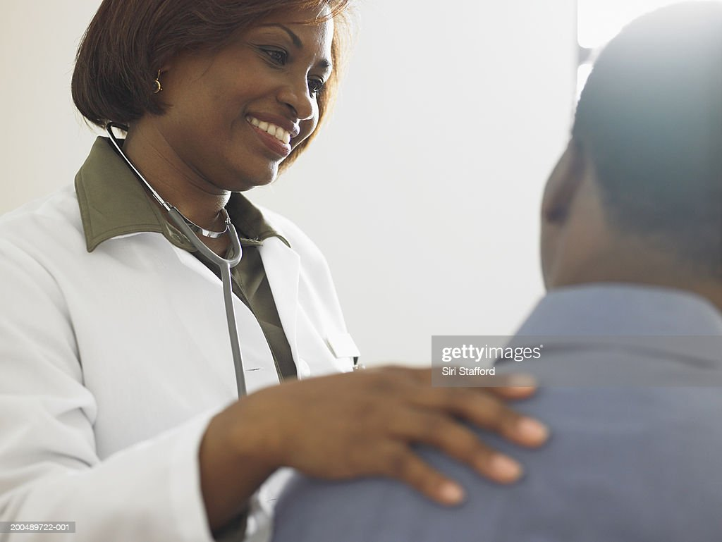 Female doctor talking to patient : Stock Photo