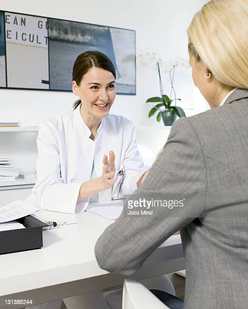 female doctor telling female patient good news
