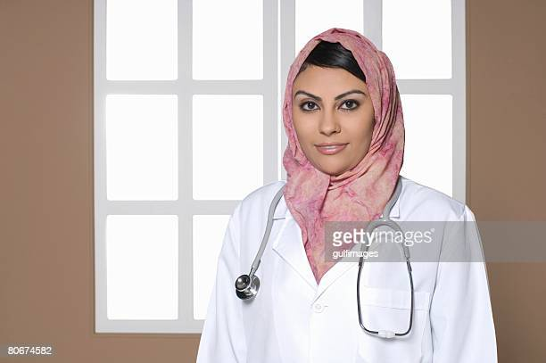 Female doctor wearing stethoscope, portrait