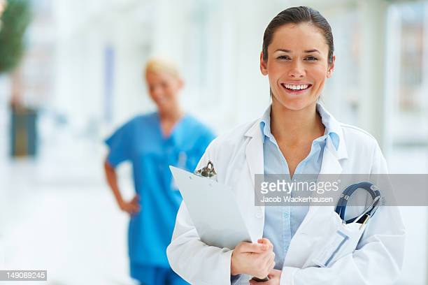 Female doctor with colleague in the background