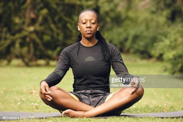 Female doing yoga meditation at park