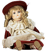 female doll sitting in red dress