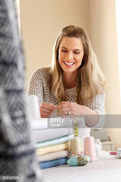 Female Dressmaker Working In Her Studio