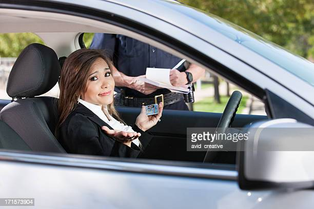 Female Driver Receiving Citation From Police