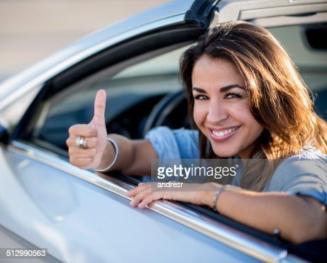 Female driver with thumbs up
