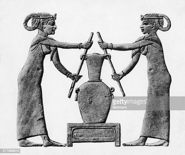Female druggists squeeze animal skin filled with herbs Egyptians used this method in making herbal medicine