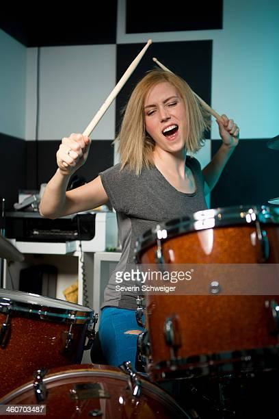 Female drummer performing