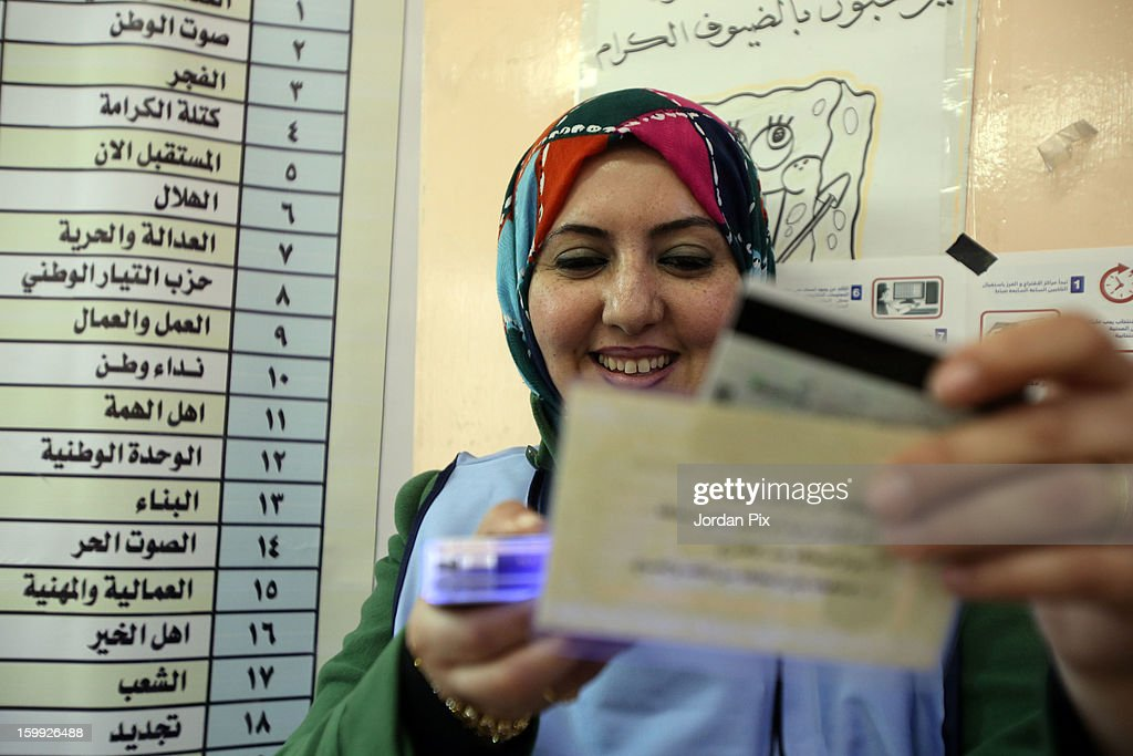A female electoral official checks documents as Jordanians vote in the parliamentary elections on January 23, 2013 in the city of Zarqa, Jordan. Jordan's election is being boycotted by the Muslim Brotherhood's political wing, the Islamic Action Front (IAF), who claim that the system is rigged favorably to supporters of the king, who for the first time will appoint the new prime minister.