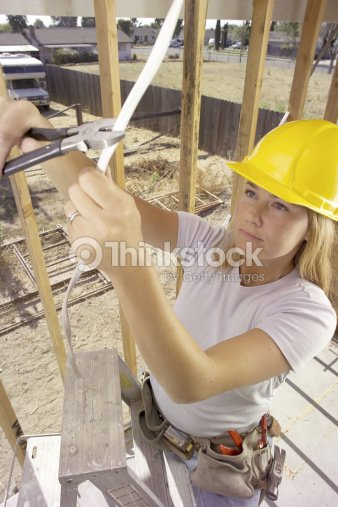 Female Electrician Cutting Wire : Stock Photo